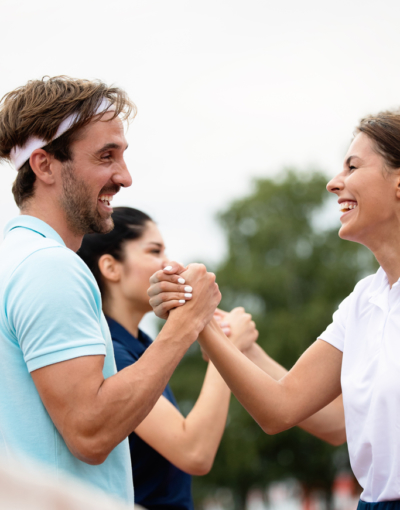 group-of-tennis-players-giving-a-handshake-after-W3ZYFQH.jpg